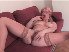 Mature blonde strips nude and toys her pussy videos