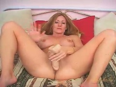 Sexy big breasts milf fucks a dildo videos