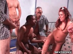 Milf blows a group of guys in a gangbang video videos