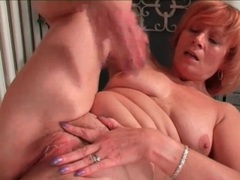 Mature redhead rubs her clit in masturbation porn videos