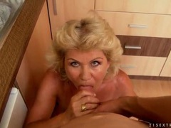 Big tits granny gives blowjob in the kitchen videos