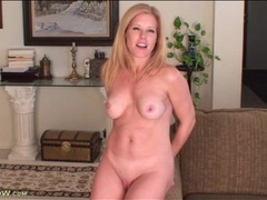 Beautiful blonde milf models her perky tits for us videos