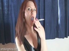 Black leather dress on a redhead in smoking porn movies at kilotop.com