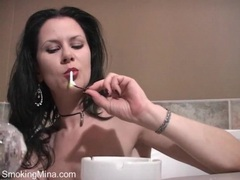 Mina smokes a cigarette in the bathtub movies at find-best-panties.com