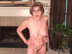 Confident mature with great tits models her pussy videos