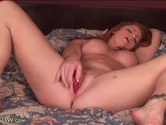 Redhead has a sexy set of fake tits to model movies at find-best-videos.com
