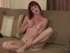 Redhead opens her coat and bares small tits videos