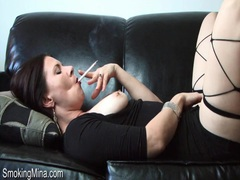 Milf in little black dress smokes and masturbates movies at kilotop.com
