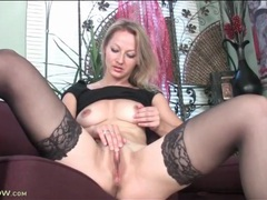 Blonde in arousing lace top stockings masturbates videos