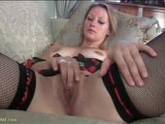 Pretty mom in black fishnet stockings masturbates videos