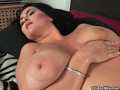 Sultry mature mom with big tits fucks herself with two dildos videos