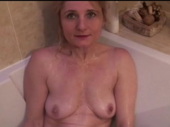 Slender mature with small tits takes a bath videos