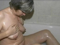 Small tits granny masturbates in the bathtub videos