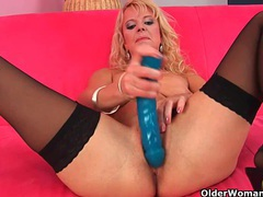 Over 50 mom probes herself with a big dildo videos