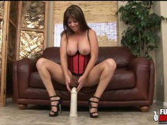 Milf in corset and heels sits on huge dildo videos