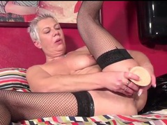 Masturbating mature wears black fishnets videos