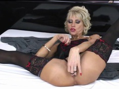 Glamorous mature blonde in lingerie masturbates movies at adspics.com