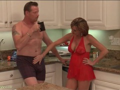 Housewife in lingerie blows her man in kitchen videos