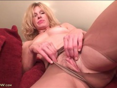 Solo blonde mom masturbates in sheer pantyhose tubes