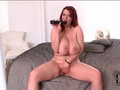 Curvy redhead fills pussy with a dildo videos