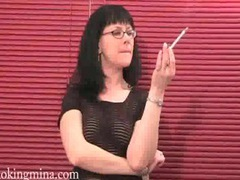 Smoking brunette in sexy pair of glasses movies at kilopills.com