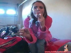 Teen in pink bathrobe smokes cigarette videos