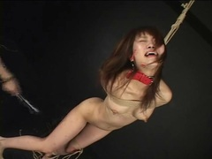 Japanese girl in pain from flogging tubes at lingerie-mania.com