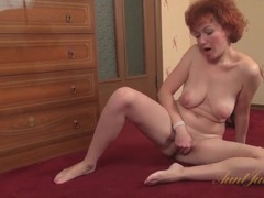 Shaved mature redhead rubs her cunt videos
