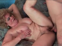 Granny with great titties sits on a cock tubes