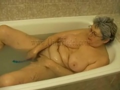 Old lady has toy sex in bathtub videos