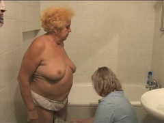Granny gets a bath from her nurse videos