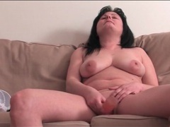 Mature takes her clothes off and masturbates clip