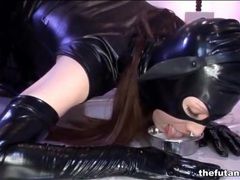 Submissive shemale wears latex for masters videos