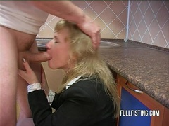 Hot bitch gets fisted and ass-fucked in the kitchen clip
