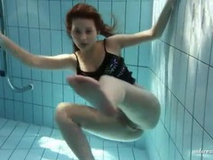 Sheer pantyhose are all wet on girl in pool videos