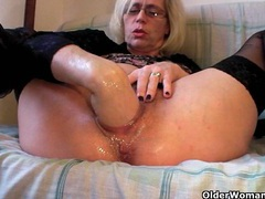Slutty grandma in stockings fists her hairy cunt videos