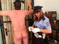 Femdom cop flogs and canes the submissive guy videos