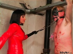 Red leather catsuit on abusive mistress videos