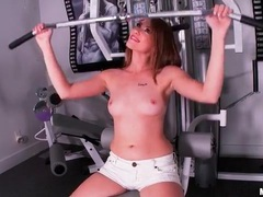 Sporty babe in lipstick strips in gym movies at kilopills.com