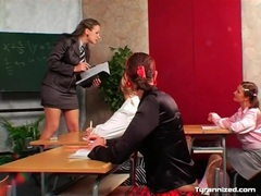 Bossy teacher and satin clad schoolgirl in class videos