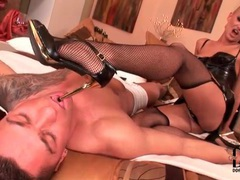 Blazing hot shaved head girl in latex and fishnets videos