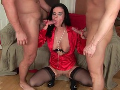 Shiny red satin blouse on double penetrated slut movies at lingerie-mania.com