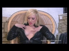 Kinky blonde slut puts on leather gear and fingers herself videos
