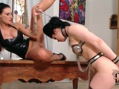 Sub girl in metal chastity lingerie submits movies at lingerie-mania.com