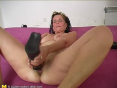 Thick black dildo pushes into mature pussy movies