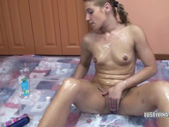 Lina covered in oil and fucking a dildo videos