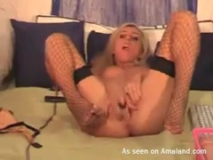 Skinny blonde beauty in fishnets masturbates videos