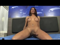 Sexy tgirl with big round tits jerks off movies