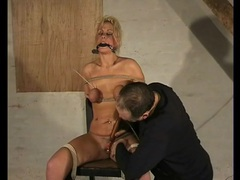 Tied and gagged girl buzzed by a toy videos