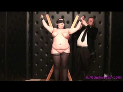 Fat girl in stockings is tied up and played with videos